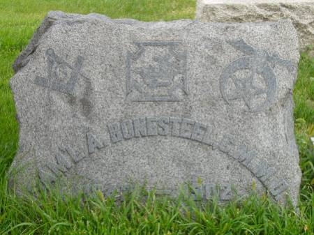 Grave marker showing three Masonic symbols