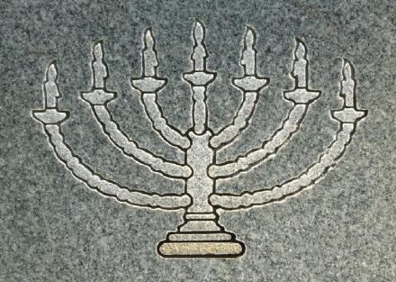 The menorah on a Jewish tombstone.